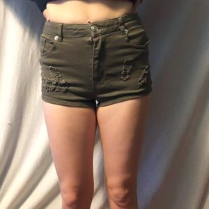 Green distressed shorts